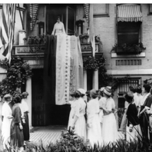 <p>Unknown photographer. <i>Alice Paul Unfurls the Ratification Flag at National Woman&rsquo;s Party Headquarters in Celebration When Tennessee Became the 36th State to Ratify the Federal Suffrage Amendment</i>, 1920. Albumen silver print. Collection of the historic National Woman&rsquo;s Party, the Sewall-Belmont House and Museum, Washington, D.C.</p>