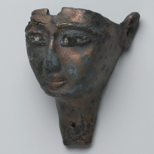 <p><i>Face from a Composite Statue</i>. Egypt, provenance not known. Third Intermediate Period, 1075–656 <small>B.C.E. </small>Bronze, 1<sup>5</sup>⁄<sub>8</sub> x 2<sup>1</sup>⁄<sub>16</sub> x 2<sup>13</sup>⁄<sub>16</sub> in. (4.1 × 5.3 × 7.2 cm). Brooklyn Museum, Gift of Evangeline Wilbour Blashfield, Theodora Wilbour, and Victor Wilbour honoring the wishes of their mother, Charlotte Beebe Wilbour, as a memorial to their father, Charles Edwin Wilbour, 16.198</p>