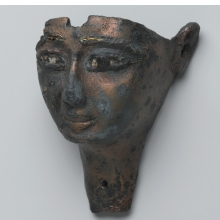<p><i>Face from a Composite Statue</i>. Egypt, provenance not known. Third Intermediate Period, 1075&ndash;656 <small>B.C.E. </small>Bronze, 1<sup>5</sup>&frasl;<sub>8</sub> x 2<sup>1</sup>&frasl;<sub>16</sub> x 2<sup>13</sup>&frasl;<sub>16</sub> in. (4.1 &times; 5.3 &times; 7.2 cm). Brooklyn Museum, Gift of Evangeline Wilbour Blashfield, Theodora Wilbour, and Victor Wilbour honoring the wishes of their mother, Charlotte Beebe Wilbour, as a memorial to their father, Charles Edwin Wilbour, 16.198</p>