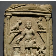 <p><i>Funerary Stela of C. Julius Valerius</i>. Egypt, exact provenance unknown, 3rd century <small>C.E.</small> Limestone, traces of paint, 14<sup>1</sup>&frasl;<sub>16</sub> x 10<sup>3</sup>&frasl;<sub>16</sub> x 1<sup>13</sup>&frasl;<sub>16</sub> in. (35.7 &times; 25.8 &times; 4.6 cm). Brooklyn Museum, Gift of Evangeline Wilbour Blashfield, Theodora Wilbour, and Victor Wilbour, honoring the wishes of their mother, Charlotte Beebe Wilbour, as a memorial to their father, Charles Edwin Wilbour, 16.105</p>