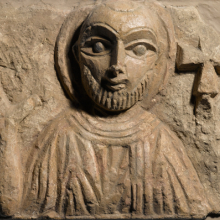 <p><i>Bust of a Saint</i>. Egypt, exact provenance unknown, 4th–5th century <small>C.E.</small> Limestone, traces of paint, 8 × 10<sup>7</sup>⁄<sub>16</sub> in. (20.3 × 26.5 cm). Brooklyn Museum, Charles Edwin Wilbour Fund, 55.2.3</p>