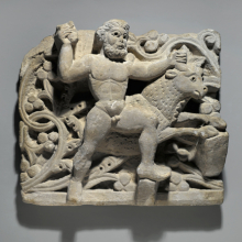 <p><i>Hercules Smiting Acheloos in the Form of a Bull</i>. Egypt, from Oxyrhynchus, c. 300–500 <small>C.E.</small> Limestone, 13<sup>3</sup>⁄<sub>8</sub> x 14<sup>3</sup>⁄<sub>4</sub> in. (34 × 37.5 cm). Brooklyn Museum, Charles Edwin Wilbour Fund, 61.128</p>