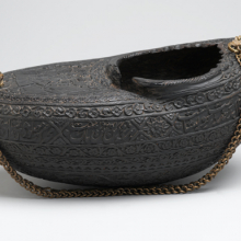 <p><i>Kashkūl</i>, or Beggar's Bowl, <i>with Portrait of Dervishes and a Mounted Falconer</i>. Iran, A.H. 1280/1880 <small>C.E.</small> Coco-de-mer shell and chain. Brooklyn Museum, Henry L. Batterman Fund, 47.203.5</p>