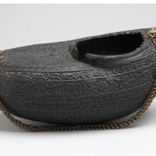 <p><i>Kashk&#363;l</i>, or Beggar&rsquo;s Bowl, <i>with Portrait of Dervishes and a Mounted Falconer</i>. Iran, A.H. 1280/1880 <small>C.E.</small> Coco-de-mer shell and chain. Brooklyn Museum, Henry L. Batterman Fund, 47.203.5</p>