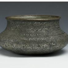 <p><i>Wine Bowl Inscribed with the Names of the Twelve Shi&#703;a Imams</i>. Iran, Safavid, late 16th&ndash;early 17th century. Copper; cast, raised, and turned, then tinned; engraved and inlaid with black composites. Brooklyn Museum, Gift of Mrs. Charles K. Wilkinson in memory of her husband, 1989.149.4</p>