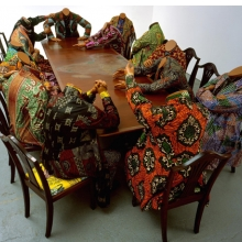 <p>Yinka Shonibare MBE (b. United Kingdom, 1962). <em>Scramble for Africa</em>, 2003. Fourteen life-size fiberglass mannequins, fourteen chairs, table, Dutch wax printed cotton, 52 &times; 192 &times; 110 in. The Pinnell Collection, Dallas. Image courtesy of the artist, Stephen Friedman Gallery, London, and James Cohan Gallery, New York. &copy; the artist. Photo: Stephen White</p>
