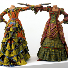 <p>Yinka Shonibare MBE (b. United Kingdom, 1962). <em>How to Blow Up Two Heads at Once (Ladies)</em>, 2006. Two life-size fiberglass mannequins, two guns, Dutch wax printed cotton, shoes, leather riding boots, plinth 63 × 96<sup>1</sup>⁄<sub>2</sub> x 48 in.; each figure 63 × 61 × 48 in. Davis Museum and Cultural Center, Wellesley College, Wellesley, Massachusetts, Museum purchase, Wellesley College Friends of Art. Image courtesy of the artist, Stephen Friedman Gallery, London, and James Cohan Gallery, New York. © the artist. Photo: Stephen White</p>