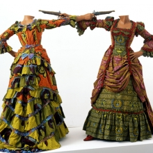 <p>Yinka Shonibare MBE (b. United Kingdom, 1962). <em>How to Blow Up Two Heads at Once (Ladies)</em>, 2006. Two life-size fiberglass mannequins, two guns, Dutch wax printed cotton, shoes, leather riding boots, plinth 63 &times; 96<sup>1</sup>&frasl;<sub>2</sub> x 48 in.; each figure 63 &times; 61 &times; 48 in. Davis Museum and Cultural Center, Wellesley College, Wellesley, Massachusetts, Museum purchase, Wellesley College Friends of Art. Image courtesy of the artist, Stephen Friedman Gallery, London, and James Cohan Gallery, New York. &copy; the artist. Photo: Stephen White</p>