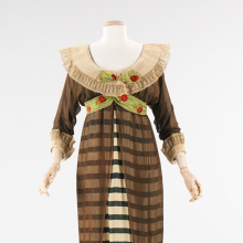 <p>Paul Poiret (French, 1879–1944). <i>Evening Dress</i>, 1910. Forest green and ivory striped silk, black silk chiffon, white cartridge pleated linen, brocaded ribbon. Brooklyn Museum Costume Collection at The Metropolitan Museum of Art, Gift of the Brooklyn Museum, 2009; Gift of Ogden Goelet, Peter Goelet, and Madison Clews in memory of Mrs. Henry Clews, 1961 (2009.300.1289)</p>