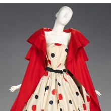 <p>Arnold Scaasi (American, born Canada, 1931). <i>Evening Ensemble</i>, 1961. Cream silk satin printed with red and black polka dots, red barathea. Brooklyn Museum Costume Collection at The Metropolitan Museum of Art, Gift of the Brooklyn Museum, 2009; Gift of Kay Kerr, 1965 (2009.300.391a&ndash;b)</p>