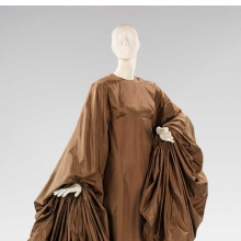 <p>Madame Alix Gr&egrave;s (French, 1903&ndash;1993). <i>Evening Dress</i>, 1969. Taupe silk paper taffeta. Brooklyn Museum Costume Collection at The Metropolitan Museum of Art, Gift of the Brooklyn Museum, 2009; Gift of Mrs. William Randolph Hearst, Jr., 1988 (2009.300.1373)</p>