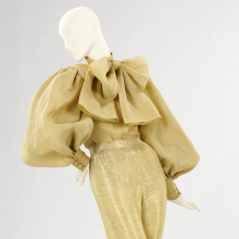 <p>Norman Norell (American, 1900–1972). <i>Evening Ensemble</i>, 1970–71. Gold organdy, beaded gold silk jersey. Brooklyn Museum Costume Collection at The Metropolitan Museum of Art, Gift of the Brooklyn Museum, 2009; Gift of Toni Tavan Ausnit, 1990 (2009.300.1383a–b)</p>
