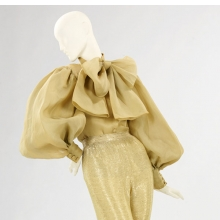 <p>Norman Norell (American, 1900&ndash;1972). <i>Evening Ensemble</i>, 1970&ndash;71. Gold organdy, beaded gold silk jersey. Brooklyn Museum Costume Collection at The Metropolitan Museum of Art, Gift of the Brooklyn Museum, 2009; Gift of Toni Tavan Ausnit, 1990 (2009.300.1383a&ndash;b)</p>
