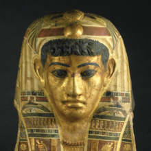Mummy Mask of a Man. Egypt, provenance not known. Roman Period, early 1st century C.E. Stucco, gilded and painted, 201⁄4 x 13 × 77⁄8 in. (51.5 × 33 × 20 cm). Brooklyn Museum, Charles Edwin Wilbour Fund, 72.57