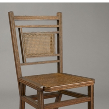 <p>George Jacob Hunzinger (American, born Germany, 1835–1898). <i>Side Chair</i>, Patented March 13, 1883. Wood, cane, straw braid, 35<sup>3</sup>⁄<sub>8</sub> x 17<sup>1</sup>⁄<sub>2</sub> x 20<sup>3</sup>⁄<sub>8</sub> in. (89.9 &#215; 44.5 &#215; 51.8 cm). Brooklyn Museum, Designated Purchase Fund, 2011.13</p>
