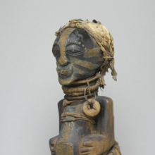 <p><em>Power Figure (Nkishi)</em>. Unidentified Songye artist, 19th or 20th century. East Kasai province, Democratic Republic of the Congo. Wood, raffia, metal, cloth, leather, horn, beads, 30 × 12 × 14<sup>3</sup>⁄<sub>4</sub> in. (76.2 × 30.5 × 37.5 cm). Museum Collection Fund, 50.79</p>
