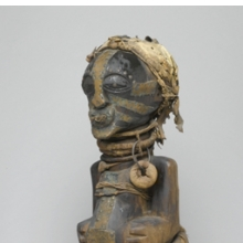 <p><em>Power Figure (Nkishi)</em>. Unidentified Songye artist, 19th or 20th century. East Kasai province, Democratic Republic of the Congo. Wood, raffia, metal, cloth, leather, horn, beads, 30 &times; 12 &times; 14<sup>3</sup>&frasl;<sub>4</sub> in. (76.2 &times; 30.5 &times; 37.5 cm). Museum Collection Fund, 50.79</p>