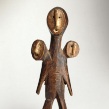 Three-Headed Figure (Sakimatwemtwe). Unidentified Lega artist. South Kivu or Maniema province, Democratic Republic of the Congo, 19th century. Wood, fiber, kaolin, 51⁄2 x 2 × 11⁄8 in. (14 × 5.1 × 2.9 cm). Brooklyn Museum, Museum Expedition 1922, Robert B. Woodward Memorial Fund, 22.486
