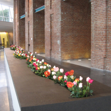 <p>Lee Mingwei (American, b. Taiwan, 1964). <i>The Moving Garden</i>, 2009. Installation view, Brooklyn Museum (2011). Stainless steel, granite, water, fresh flowers, 2 × 4.4 × 39.4 ft. (0.6 × 1.34 × 12 m). Collection of Amy and Leo Shih, Taichung, Taiwan</p>