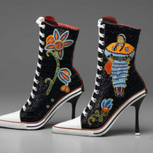 <p>Teri Greeves (Kiowa, b. 1970). <i>Great Lakes Girls</i>, 2008. Glass beads, bugle beads, Swarovski crystals, sterling silver stamped conchos, spiny-oyster shell cabochons, canvas high-heeled sneakers, 11<sup>1</sup>⁄<sub>2</sub> x 9 × 3 in. (29.2 × 22.9 × 7.6 cm). Brooklyn Museum, Gift of Stanley J. Love, by exchange, 2009.1a-b</p>