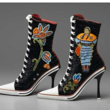 <p>Teri Greeves (Kiowa, b. 1970). <i>Great Lakes Girls</i>, 2008. Glass beads, bugle beads, Swarovski crystals, sterling silver stamped conchos, spiny-oyster shell cabochons, canvas high-heeled sneakers, 11<sup>1</sup>⁄<sub>2</sub> x 9 &#215; 3 in. (29.2 &#215; 22.9 &#215; 7.6 cm). Brooklyn Museum, Gift of Stanley J. Love, by exchange, 2009.1a-b</p>