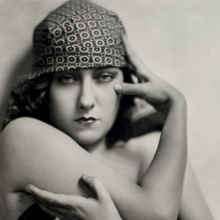 <p>Nickolas Muray (American, 1892–1965). <em>Gloria Swanson</em>, circa 1925. Gelatin silver print, 12<sup>3</sup>⁄<sub>4</sub> x 9<sup>3</sup>⁄<sub>8</sub> in. (32.4 × 23.8 cm). George Eastman House, International Museum of Photography and Film, Rochester, New York, Gift of Mrs. Nickolas Muray. © Estate of Nickolas Muray</p>