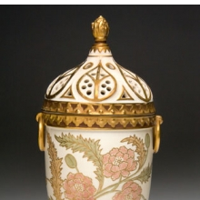 <p>Edward Lycett (American, b. England, 1833–1910). Faience Manufacturing Company (1881–92). <i>Covered Vase</i>, 1886–90. Cream-colored earthenware painted over ivory-glazed ground with polychrome enamels and flat and raised gold paste decoration. Nally-Stufano Collection</p>