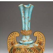 <p>Edward Lycett (American, b. England, 1833&ndash;1910). Faience Manufacturing Company (1881&ndash;92). <i>Vase</i>, 1886&ndash;90. Cream-colored earthenware with mottled blue, black, and maroon glazed ground with flat and raised gold paste decoration and enamel jewels. Collection of Andrew Van Styn</p>