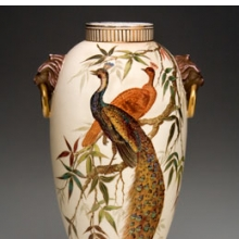 <p>Edward Lycett (American, b. England, 1833–1910). Faience Manufacturing Company (1881–92). <i>Vase</i>, 1886–90. Cream-colored earthenware painted over ivory glazed ground with polychrome enamels; flat and raised gold paste decoration. Collection of Michael and Marjorie Loeb</p>
