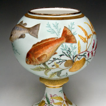<p>Edward Lycett (American, b. England, 1833–1910). Faience Manufacturing Company (1881–92). <i>Vase</i>, 1886–90. Cream-colored earthenware applied with molded fish and shells; painted over ivory or gray-green glazed ground with polychrome enamels; flat and raised gold paste decoration. Collection of Barrie and Deedee Wigmore</p>
