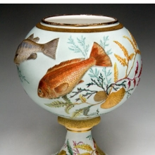 <p>Edward Lycett (American, b. England, 1833&ndash;1910). Faience Manufacturing Company (1881&ndash;92). <i>Vase</i>, 1886&ndash;90. Cream-colored earthenware applied with molded fish and shells; painted over ivory or gray-green glazed ground with polychrome enamels; flat and raised gold paste decoration. Collection of Barrie and Deedee Wigmore</p>