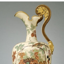 <p>Edward Lycett (American, b. England, 1833–1910). Faience Manufacturing Company (1881–92). <i>Ewer</i>, 1886–90. Cream-colored earthenware with ivory glazed ground painted with polychrome enamels; flat and raised gold paste decoration. The Jacobsen Collection</p>