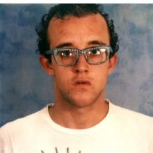 <p>Keith Haring (American, 1958&ndash;1990). <i>Self-Portrait with Glasses Painted by Kenny Scharf</i>, circa 1980. Polaroid photograph. Collection Keith Haring Foundation. &copy; Keith Haring Foundation</p>