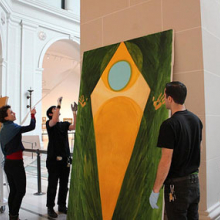 "<p>Shura Chernozatonskaya and Museum staff install <i>Devotion</i>, one of a pair of paintings that responds to the ""Art and Devotion"" section of the installation <i>European Paintings</i>, in the Beaux-Arts Court</p>"