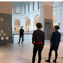 "<p>Shura Chernozatonskaya and curator Eugenie Tsai work with Museum staff to install <i>Russian Modern</i>, one of a pair of paintings that responds to the ""Russian Modern"" section of the installation <i>European Paintings</i>, in the Beaux-Arts Court</p>"