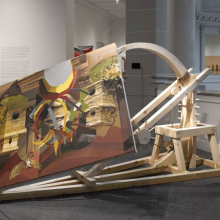 "<p>Caitlin Cherry (American, b. 1987). <i>Dual-Firing Trebuchet Artcraft ""Virgin On The Rocks,""</i> 2013. Brooklyn Museum installation. Oil on canvas with wood and rope construction, 108 × 108 × 48 in. (274.32 × 274.32 × 121.92 cm); overall dimensions variable. Courtesy of the artist (Photo: Brooklyn Museum)</p>"