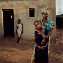 <p>Jonathan C. Torgovnik (American, b. 1969). <em>Valentine with her daughters Amelie and Inez, Rwanda</em>, from the series <em>Intended Consequences</em>, 2006. Chromogenic print, ed. 11/25, 24 × 20 in. (61 × 50.8 cm). The Museum of Fine Arts, Houston, gift of the artist. © Jonathan Torgovnik</p>