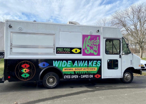 <p>The Wide Awakes Mobil Soup Kitchen food truck parked outdoors</p>