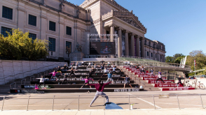 <p>Participants practice socially distant yoga on the Brooklyn Museum steps</p>