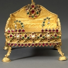 <p><i>Miniature Shrine for an Icon or Ritual Object</i>. Southern India, 19th century. Gold, rubies, emeralds, diamonds, and pearls, 5<sup>1</sup>⁄<sub>8</sub> x 3<sup>5</sup>⁄<sub>8</sub> x 3<sup>1</sup>⁄<sub>8</sub> in. (13 × 9.2 × 8 cm). Collection of Susan L. Beningson</p>
