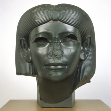 <p><i>Head from a Female Sphinx</i>, circa 1876–1842 <small>B.C.E.</small> Middle Kingdom, reign of Amenemhat II. Heliopolis, Egypt. Chlorite, 15<sup>5</sup>⁄<sub>16</sub> x 13 × 13<sup>15</sup>⁄<sub>16</sub> in. (38.9 × 33.3 × 35.4 cm). Brooklyn Museum; Charles Edwin Wilbour Fund, 56.85</p>