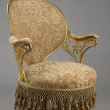 "<p>Thomas E. Warren (American, 1808–18?). <i>""Centripetal Spring"" Chair</i>, patented September 25, 1849. Manufactured by the American Chair Company (active 1829–1858). Cast iron, sheet metal, wood, modern upholstery, original fringe, 34<sup>1</sup>⁄<sub>4</sub> x 23<sup>1</sup>⁄<sub>2</sub> x 28<sup>1</sup>⁄<sub>4</sub> in. (87 × 59.7 × 71.8 cm). Brooklyn Museum, Designated Purchase Fund, 2009.27</p>"