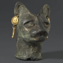 <p><em>Cat's Head</em>. From Egypt. Roman Period, 30 <small>B.C.E.</small>–third century <small>C.E.</small> Bronze, gold, 2<sup>3</sup>⁄<sub>8</sub> x 1<sup>3</sup>⁄<sub>4</sub> x 11<sup>3</sup>⁄<sub>16</sub> in. (6 × 4.4 × 4.6 cm). Brooklyn Museum, Charles Edwin Wilbour Fund, 36.114</p>