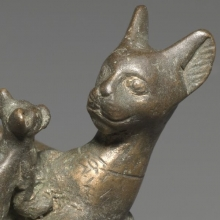 <p><em>Cat with Kittens</em> (detail). Reportedly from Saqqara, Egypt. Late Period to Ptolemaic Period, Dynasty 26 or later, circa 664–30 <small>B.C.E.</small> Bronze, solid-cast and wood, 2<sup>3</sup>⁄<sub>8</sub> x 3<sup>7</sup>⁄<sub>16</sub> x 1<sup>15</sup>⁄<sub>16</sub> in. (6.1 × 8.8 × 5 cm). Brooklyn Museum, Charles Edwin Wilbour Fund, 37.406E</p>