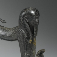 <p><em>Striding Sphinx Finial</em>. From Egypt. Third Intermediate Period, Dynasty 22 to Dynasty 24, circa 945–712 <small>B.C.E.</small> Bronze, 5<sup>1</sup>⁄<sub>2</sub> x 1<sup>5</sup>⁄<sub>8</sub> x 5 in. (14 × 4.1 × 12.7 cm). Brooklyn Museum, Charles Edwin Wilbour Fund, 61.20</p>