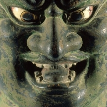 <p><em>Head of a Guardian. </em>Japan. Kamakura period (1185–1333), 13th century. Hinoki wood with polychrome, inlaid rock crystal eyes, filigree metal crown, 22<sup>1</sup>⁄<sub>16</sub> x 10<sup>1</sup>⁄<sub>4</sub> x 13<sup>15</sup>⁄<sub>16</sub> (56.0 × 26.0 × 35.5 cm). Brooklyn Museum, Gift of Mr. and Mrs. Alastair B. Martin, the Guennol Collection, 86.21</p>