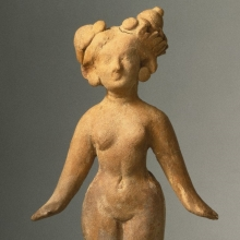 <p><em>Standing Female</em>. Pakistan, possibly Charsadda or Sirkap. Kushan period, 1st century. Red molded terracotta, 6<sup>7</sup>⁄<sub>8</sub> in. (17.5 cm) high. Brooklyn Museum, Gift of Georgia and Michael de Havenon, 88.194</p>