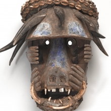 <p>Left: Unidentified Sapo artist. <em>Mask</em> (Gela), 20th century, Sinoe or Grand Gedeh county, Liberia. Wood, metal, cowrie shell, pigment, animal teeth, antelope and duiker horn, boar tusk, plant fibers, textile, earth, ceramic. Brooklyn Museum, Gift of Mr. and Mrs. J. Gordon Douglas III and Dr. and Mrs. Milton Gross, by exchange, 2013.61.1; Right: Unidentified Bamileke artist. <em>Kuosi Society Elephant Mask</em>, 20th century, Grassfields region, Cameroon. Cloth, beads, raffia, fiber, 56<sup>3</sup>&frasl;<sub>4</sub> x 21<sup>1</sup>&frasl;<sub>2</sub> in. (144.1 &times; 54.5 cm). Brooklyn Museum, Gift of Frieda B. and Milton F. Rosenthal, 81.170. (Photos: Brooklyn Museum)</p>