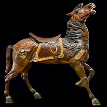 <p>Charles Carmel (American, born Russia, 1865–1931). <em>Carousel Horse with Raised Head, Coney Island, Brooklyn, New York</em>, circa 1914. Paint on wood, jewels, glass eyes, horsehair tail, 62 × 58 × 14 in. (157.5 × 147.3 × 36.6 cm). Collection of American Folk Art Museum, New York; Gift of Laura Harding, 1978.18.2</p>