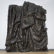 <p>El Anatsui (Ghanaian, born 1944). <em>Black </em><em>Block</em>, 2010. Aluminum and copper wire, two pieces, each: 207 &times; 133<sup>1</sup>&frasl;<sub>2</sub> in., 67 lb. (525.8 &times; 339.1 cm, 30.39kg). Brooklyn Museum, Bequest of William K. Jacobs, Jr., by exchange, 2013.7a, b. &copy; El Anatsui. (Photo: Jonathan Dorado, Brooklyn Museum)</p>